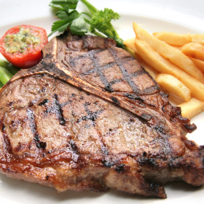 Porterhouse Steak con papas al horno